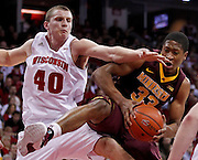 Minnesota's Rodney Williams, right, pulls in an offensive rebound against Wisconsin's Jared Bergrren during the first half of an NCAA college basketball game. (AP Photo/Andy Manis)