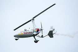 June 2, 2017 - Torbay, Devon, UK - Torbay, Devon, UK. Torbay Airshow 2017. Press call for Launch of the 2017 Torbay Airshow. An Autogyro performs a display over Tor Bay ahead of the 2017 Torbay Airshow. The Autogyro flying display, also known as a Gyrocopter or Gyroplane, is described as a flying windmill or a rotating parachute which looks like a sycamore seed gently floating down as it spins.The 2017 Torbay Airshow is set to return this weekend on Saturday 3 and Sunday 4 June with an action packed programme of world class air displays. The world's premier aerobatic team The Red Arrows will be debuting a new routine in the first display of their season, featuring their trademark combination of close formations and precision flying. The full display programme for the weekend begins on the Saturday between 2-3pm with The Tigers Freefall Parachute Display Team, Team Raven Aerobatic Display Team, the Percival Piston Provost and the Strikemaster. From 3-4pm will be the highly anticipated display by the Red Arrows, former British Female Aerobatic Champion Lauren Richardson in her Pitts Special S1-S and world aerobatic competitor Gerald Cooper in his Xtreme XA41. Finishing off the action packed afternoon from 4-5pm will see displays from the AutoGyro, the Battle of Britain Memorial Flight aircraft, the PBY5A Catalina seaplane, The Blades and the Royal Air Force's Typhoon FGR4. Sunday afternoon will see each of the aircraft take to the skies again before the weekend closes with a final display from the RAF Chinook team. The two day show, which had its inaugural event last year, takes place on Paignton Green with the Bay providing a stunning natural amphitheatre for viewing the air displays and the perfect location for a large coastal airshow event. To stay up to date with the latest Torbay Airshow news and updates follow @torbayairshow on Facebook, Twitter and Instagram or visit www.torbayairshow.com. Picture credit : Simon Chapman/LNP (Credit Image: © S