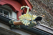 A dragon gargoyle decorates a rain gutter in Stein am Rhein, a well-preserved medieval center in Schaffhausen Canton, Switzerland, Europe. The legend of St. George slaying a dragon was a brought back with the Crusaders. According to legend, St. George (who may have lived about AD 280-303) was a Roman soldier of Greek origin and officer in the Guard of Roman emperor Diocletian, who ordered his death for failing to recant his Christian faith. As a Christian martyr, he later became one of the most venerated saints in Christianity.