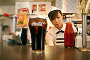 Waitress working in a diner.