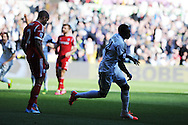 Swansea city's Roland Lamah ® celebrates after he scores his sides 1st goal. Barclays Premier league match, Swansea city v West Bromwich Albion at the Liberty Stadium in Swansea, South Wales on Saturday 15th March 2014. pic by Andrew Orchard,  Andrew Orchard sports photography.