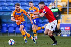 Jason Law of Mansfield Town chases down Sam Lavelle of Morecambe - Mandatory by-line: Ryan Crockett/JMP - 27/02/2021 - FOOTBALL - One Call Stadium - Mansfield, England - Mansfield Town v Morecambe - Sky Bet League Two