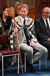 The Duke of Sussex is given a Maori Tewha Tewha weapon during a visit to Te Papaiouru, Ohinemutu, in Rotorua, before a lunch in honour of Harry and Meghan, on day four of the royal couple's tour of New Zealand.