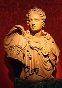 Lucas Faydherbe (1617-1697) Omphale, Terracotta.  Faydherbe was from a dynasty of sculptors in Mechelen (today in Belgium).  He worked in Ruben's studio for three years from 1636 and was strongly influenced by him. In classical legend, Omphale, Queen of Lydia, kept the hero Hercules as her slave and lover.  The subject was popular in the 1600s.  This bust was probably designed to be seen from below as part of the decoration of a domestic doorway.  This is one of three almost identical busts.