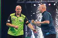 Michael van Gerwen acknowledges his opponent Rob Cross at the end of the match during the Unibet PDC Premier League of darts at Marshalls Arena, Stadium MK, Milton Keynes, England. UK on 7 April 2021.