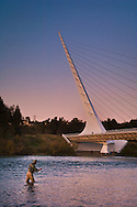 Fisherman in front of the Sundial Bridge on the Sacramento River, Redding, California