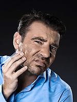 caucasian man unshaven tootache hangover portrait isolated studio on black background