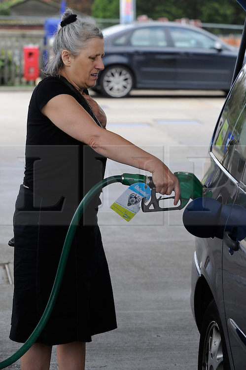 © Licensed to London News Pictures. 30/03/2012. A woman buying diesel at Ashdene BP service station in Hurst Green, East Sussex on March 30, 2012. Photo credit : Grant Falvey/LNP