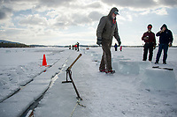 The time honored traditional ice harvest on Squam Lake for Rockywold Deephaven Camps takes a mid day break as they work to fill up their two ice houses for summer campers on Tuesday. ©2018 Karen Bobotas Photographer
