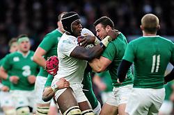 Maro Itoje of England takes on the Ireland defence - Mandatory byline: Patrick Khachfe/JMP - 07966 386802 - 27/02/2016 - RUGBY UNION - Twickenham Stadium - London, England - England v Ireland - RBS Six Nations.