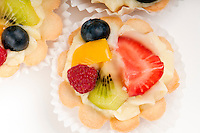 Dessert made of fruit salad over a voulavent pastry. Volauvent is a tiny round canape made of puff pastry. The term ' vol au vent ' means ' blown by the wind ' in French.