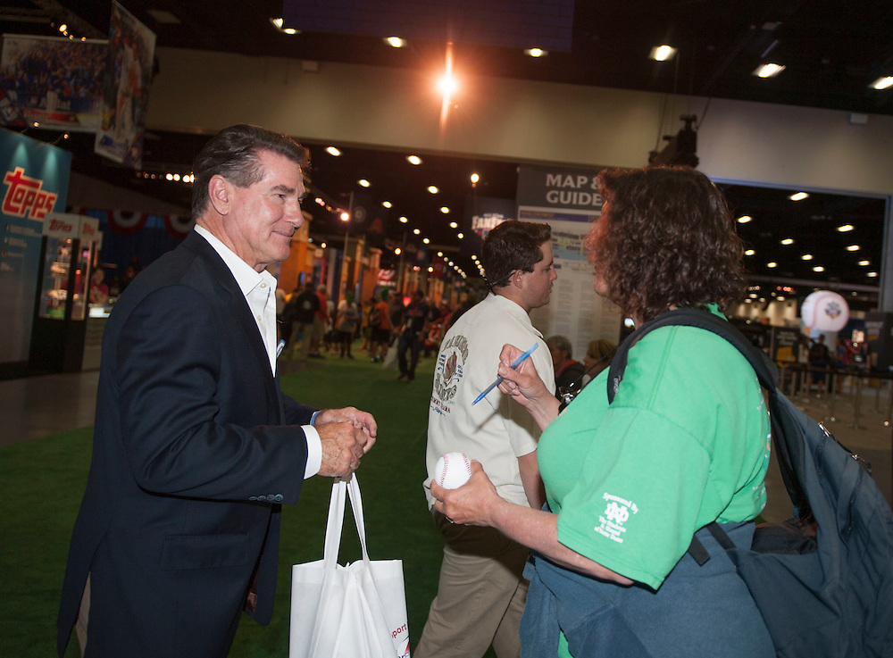 Steve Garvey signs an autograph for a fan during the 2016 MLB All-Star FanFest at the San Diego Convention Center on Friday.<br /> <br /> ///ADDITIONAL INFO:   <br /> <br /> Fanfest.0709.kjs  ---  Photo by KEVIN SULLIVAN / Orange County Register  -- 7/8/16<br /> <br /> The 2016 MLB All-Star game Fan Fest at Petco Park and the San Diego Convention Center.