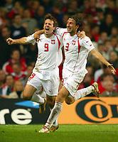 Fotball<br /> VM-kvalifisering<br /> Wales v Polen<br /> 13.10.2004<br /> Foto: BPI/Digitalsport<br /> NORWAY ONLY<br /> <br /> Wales v Poland. FIFA World Cup European Qualifying Group Six. Millenium Stadium. 13/10/2004.<br /> <br /> Maciej Zurawski (L) celebrates his goal with Kamil Kosowski