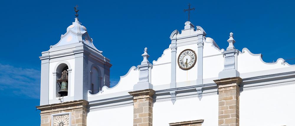 Church of Saint Antao - Igreja de Santo Antao - with clock and bell tower in Giraldo Square - Praca do Giraldo - Evora, Portugal