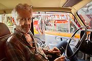 Smiling Senior Man In Vintage Car