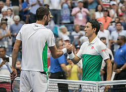 September 5, 2018 - Flushing Meadows, New York, U.S - Kei Nishikori shakes hands after his win with Marin Cilic on Day 10 of the 2018 US Open at USTA Billie Jean King National Tennis Center on Wednesday September 5, 2018 in the Flushing neighborhood of the Queens borough of New York City. Nishikori defeats Cilic, 6-2, 4-6, 7-6(7-5), 4-6, 6-4. (Credit Image: © Prensa Internacional via ZUMA Wire)
