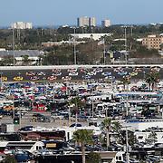The pack is seen in turn three during the 58th Annual NASCAR Daytona 500 auto race at Daytona International Speedway on Sunday, February 21, 2016 in Daytona Beach, Florida.  (Alex Menendez via AP)
