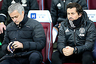 Jose Mourinho, the Manchester United manager  (l) sitting next to Rui Faria, the Manchester United assistant manager in the dugout . Premier league match, West Ham Utd v Manchester Utd at the London Stadium, Queen Elizabeth Olympic Park in London on Monday 2nd January 2017.<br /> pic by John Patrick Fletcher, Andrew Orchard sports photography.