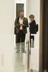Westminster, September 20th 2016. Labour Leader Jeremy Corbyn speakers with a woman in the lobby of Southside House as he leaves the Labour Party Headquarters following a meeting of the NEC.