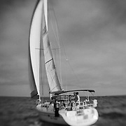 Sailboat Go Time Under Full Sail Stern View - Newport Beach, CA - Lensbaby - Black & White
