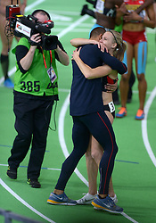 United States' Ashton Eaton (L,front) hugs his wife, Canada's Brianne Theisen Eaton after she won the women's 800-meter sprint of the pentathlon and the overall pentathlon event during day two of the IAAF World Indoor Championships at Oregon Convention Center in Portland, Oregon, the United States, on March 18, 2016. EXPA Pictures © 2016, PhotoCredit: EXPA/ Photoshot/ Yin Bogu<br /> <br /> *****ATTENTION - for AUT, SLO, CRO, SRB, BIH, MAZ, SUI only*****