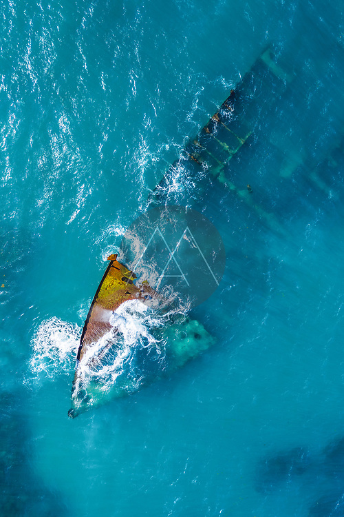 """Aerial view of a sunken and abandoned ship near """"Arena Gorda"""" beach during the day, Punta Cana, Dominican Republic"""