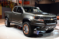 "12 February 2015: 2015 CHEVROLET COLORADO:  Starring inside the Chevrolet exhibit during the 107th Chicago Auto Show is the 2015 Chevrolet Colorado that redefines the midsize truck. Developed for the North American truck customer, the aggressive design is unique, with taller bedsides and raked belt line of the cab described as ""the younger, more eager brother of the Silverado.""  For the 2015 model year, the redefined Colorado is available in WT, LT and Z71 trim levels, and in rear-wheel and all-wheel drive configurations. Body/bed layouts come in an extended cab model with a six-ft. two-in. bed, a crew cab with a five-ft. two-in. bed and a crew cab with a six-ft. two-in. bed. With the tailgate down, the six-foot bed allows hauling of eight-foot-long items. Two engines on the checklist include the 193-horsepower 2.5-liter four-cylinder engine, and a 302-hp 3.6L V-6, with each connected with a six-speed automatic transmission. There is a six-speed manual gearbox offered on extended cab two-wheel Work Truck models. In 2016, Colorado will begin offering the segment's only diesel engine – a proven Duramax 2.8L I-4 turbodiesel. The diesel engine will expand Colorado's powertrain lineup to cover the broadest range of needs. When properly equipped, the Colorado offers class leading payload capacity and trailering capacity of more than 6,700 pounds. For those looking for the brawniest Colorado, check-out the off-road-inspired Z71with its gunmetal grille surround, projector headlamps and unique 17-inch aluminum wheels.<br /> <br /> First staged in 1901, the Chicago Auto Show is the largest auto show in North America and has been held more times than any other auto exposition on the continent. The 2015 show marks the 107th edition of the Chicago Auto Show. It has been  presented by the Chicago Automobile Trade Association (CATA) since 1935.  It is held at McCormick Place, Chicago Illinois"