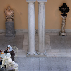 Visitors rest in the European art and sculpture court at the Walter's Art Museum in the Mount Vernon neighborhood of Baltimore...Photo by Susana Raab