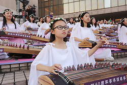 October 4, 2018 - Hong Kong, China - Young students perform traditional music pieces on Chinese classic harps outdoor as part of continued China national day celebration in Hong Kong. (Credit Image: © Liau Chung-ren/ZUMA Wire)