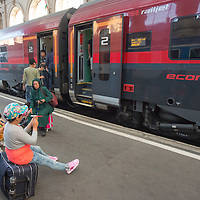 Illegal migrant family waits for their train to travel to Germany at the main railway station Keleti in Budapest, Hungary on August 31, 2015. ATTILA VOLGYI