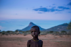 A child wakes up before the sun comes up to take their family's goats out for grazing in the Melako Conservancy in Northern Kenya. Melako is a vast expanse of arid bushland that stretches towards the Ethiopian and Somali border. Rainfall is rare, as are permanent settlements and solid infrastructure, yet the community have been grazing this rangeland for decades. <br /> One of the most important parts of Melako becoming part of the Northern Rangelands Trust   is the security it brings to the communities. Today, community rangers are on daily patrol in Melako and these community conservancies have transformed people's lives, secured peace and help them to conserve natural resources.