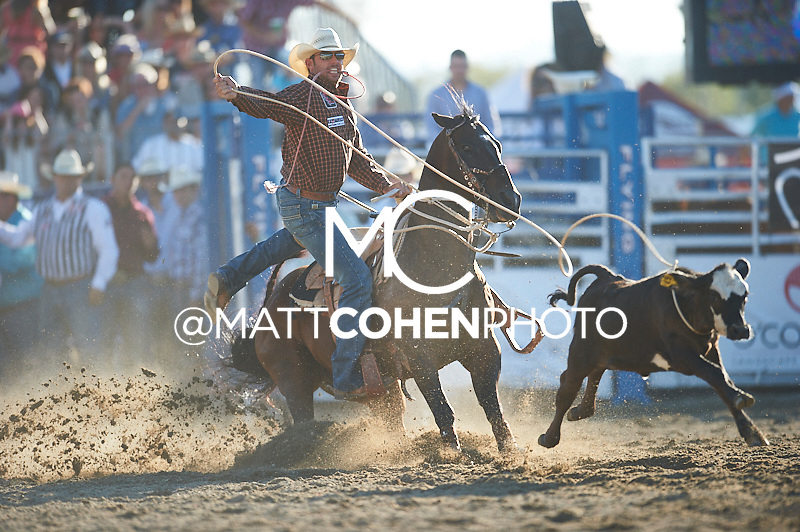 Tie-down roper Cade Swor of Winnie, TX competes at the Rancho Mission Viejo Rodeo in San Juan Capistrano, CA.<br /> <br /> <br /> UNEDITED LOW-RES PREVIEW<br /> <br /> <br /> File shown may be an unedited low resolution version used as a proof only. All prints are 100% guaranteed for quality. Sizes 8x10+ come with a version for personal social media. I am currently not selling downloads for commercial/brand use.