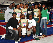 Evant Orange, Isaiah Green, Joey Hughes and Bryshon Nellum of Long Beach Poly High (Calif.) pose with coaches and supporters after winning the Championship of America 4 x 400-meter relay in 3:09.89 in the 113th Penn Relays at the University of Pennsylvania's Franklin Field on Saturday, April 28, 2007. The time was the No. 2 mark in meet history and marked the first time a high school team has run under 3:10 since 2001.