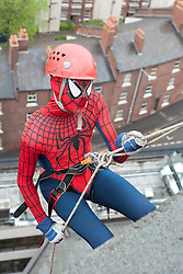 Last man over the top Spiderman AKA Plusnet employee Ben Laker at the Plusnet and Hill Dickinson Charity Abseil 111 feet down the Balance building in Sheffield to raise money for Roundabout and Saint Lukes Hospice on Wednesday <br /> <br /> 11 June 2013<br /> Image © Paul David Drabble<br /> www.pauldaviddrabble.co.uk