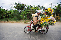 """Flower delivery, Hue, Vietnam<br /> Available as Fine Art Print in the following sizes:<br /> 08""""x12""""US$   100.00<br /> 10""""x15""""US$ 150.00<br /> 12""""x18""""US$ 200.00<br /> 16""""x24""""US$ 300.00<br /> 20""""x30""""US$ 500.00"""