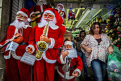 November 10, 2016 - SãO Paulo, São Paulo, Brazil - SAO PAULO, BRAZIL -  SHOPPING NATAL SP : The month of December has hardly begun and the famous 25 de Março Street, in the central region of São Paulo, is already moving intensely for Christmas shopping. Even with the current economic scenario, thousands of people circulate daily in search of resale items, gifts, and Christmas decorations that have more popular prices on the famous way. The trade near March 25, one of the most popular streets for popular shopping in São Paulo, has an average turnover of R $ 120 million per day. This value almost triples when considering special dates like Christmas, reaching the house of $ 300 million daily in the region's trade. (Credit Image: © Cris Faga via ZUMA Wire)