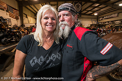 Cheryl and Mailman Kevin O'Brien at Bill Dodge's Blings Cycle shop during Biketoberfest. Daytona Beach, FL, USA. Friday October 20, 2017. Photography ©2017 Michael Lichter.