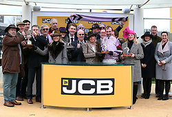 Nico de Boinville (centre), trainer Nicky Henderson and Owners Group 31 after victory in the JCP Triumph Hurdle during Gold Cup Day of the 2019 Cheltenham Festival at Cheltenham Racecourse.
