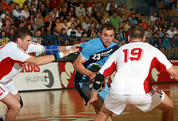Uros Zorman of Slovenia between Matej Fazik and Juraj Niznan (19) of Slovakia at  handball game between men national teams of Slovenia and Slovakia, first qualification game for the World Chamionship 2009, on June 7, 2008, in Arena Zlatorog, Celje, Slovenija. Result: 33 : 33. (Photo by Vid Ponikvar / Sportal Images)