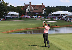September 20, 2018 - Atlanta, GA, USA - Tiger Woods hits his fairway shot to the 18th green, where he made a birdie putt to finish 5-under par, during the first round of the Tour Championship on Thursday, Sept. 20, 2018, in Atlanta, Ga. (Credit Image: © Curtis Compton/Atlanta Journal-Constitution/TNS via ZUMA Wire)