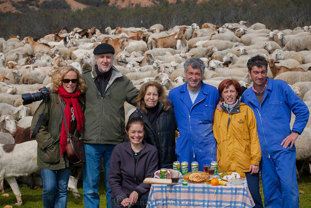 Peter Menzel and Faith D'Aluisio, authors of the book What I Eat: Around the World in 80 Diets, with sheepherder Miguel Martinez (center in blue overalls), his girlfriend and his brother; and translators and assistants in Zarzuela de Jadraque, Spain. (Miguel Martinez is featured in the book What I Eat: Around the World in 80 Diets.)