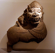 Basement decor. lion passant overlapped by a small person. Tra Kieu Style (10th century) Sandstone sculpture from Tra Kieu in Vietnam