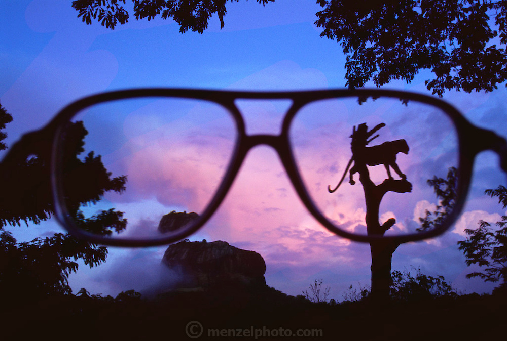 Sigirya, Sri Lanka. 5th century fortress and View of fortress and Jaguar sign thru Sir Arthur Clarke's glasses. Sir Arthur is best known for the book 2001: A Space Odyssey.