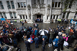 © Licensed to London News Pictures. 24/09/2019. London, UK. GINA MILLER stands with her legal team in the doorway of The Supreme Court in London as Plaid Cymru leader Liz Saville Roberts (L), SNP MP Ian Blackford & Green MP Caroline Lucas talks to reporters after it was ruled that Boris Johnson's suspension of Parliament was illegal. The case has been brought by remain campaigner Gina Miller, with support from former British Prime Minister John Major. Photo credit: Peter Macdiarmid/LNP