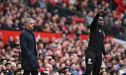 Manchester United manager Jose Mourinho (left) and West Brom Albion caretaker manager Darren Moore