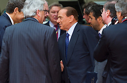 Silvio Berlusconi, Italy's prime minister, center, arrives for the European Summit meeting at EU Council headquarters in Brussels, Belgium, on Thursday, June 17, 2010. (Photo © Jock Fistick)