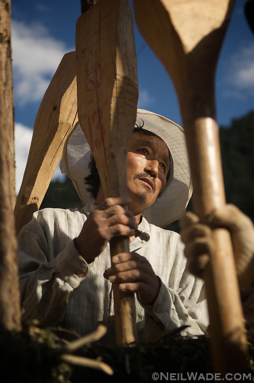 These workers were singing as they built a traditional mud house in Dege, China (Tibet).
