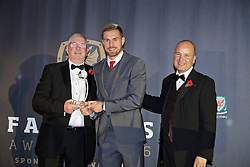 CARDIFF, WALES - Tuesday, November 8, 2016: Wales' Aaron Ramsey receives the Euro 2016 Player of the Tournament award from FAW President David Griffiths and Chief-Executive Jonathan Ford during the FAW Awards Dinner at the Vale Resort. (Pic by David Rawcliffe/Propaganda)