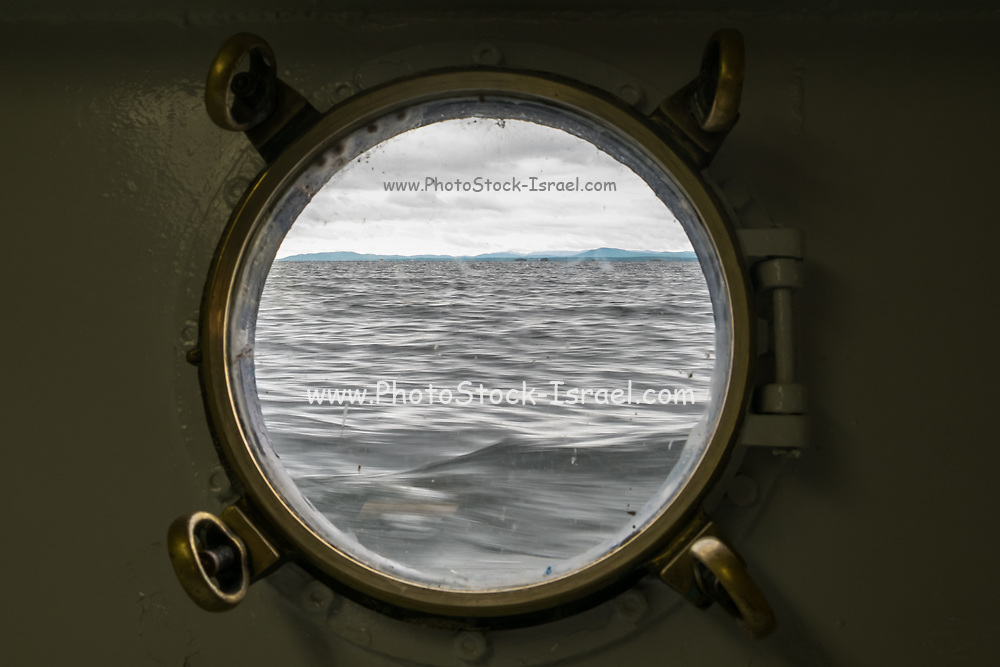 The sea as seen through a porthole in a ship