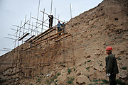 JINGTAI, CHINA - JUNE 20: (CHINA OUT) <br /> <br /> City inside 12 meter high walls<br /> <br /> Workers set up scaffolding to strengthen the city wall of the Yongtai Acient City on June 19, 2015 in Jingtai County, Gansu Province of China. The Yongtai Ancient City, also known as the Turtle city, was built in 1608 during the Ming Dynasty (1368-1644). With a perimeter of 1,717 meters, the city wall is 12 meters in height. The city also has a six-meter wide and one-to-2.5-meter deep moat. In 2006, the city was listed as the sixth batch of nation key cultural relic preservation organ. There are more than 100 villagers still living in the city. <br /> ©Exclusivepix Media
